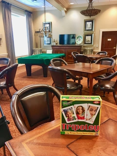 """Fun & Friendship: Residents at The Terraces are dealt a hand of happiness  with the game """"Tripoley"""""""